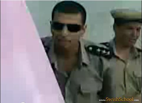 فيديو ظابط الحرس الجامعي يضرب طالبه بالكرباج أمام الجميع