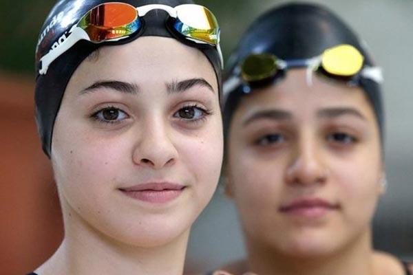 yousra mardini يسرى مارديني يسرى مارديني لاجئة سورية بمئة رجل في الاولمبياد